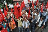 CPIM activists raise slogans during a protest against hike in fuel prices in Shimla on Monday.Photo by: Amit Kanwar