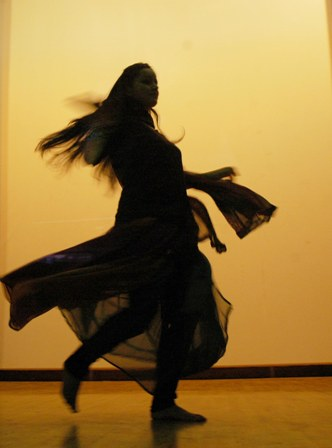 A dancer gives a performance at a Shimla college