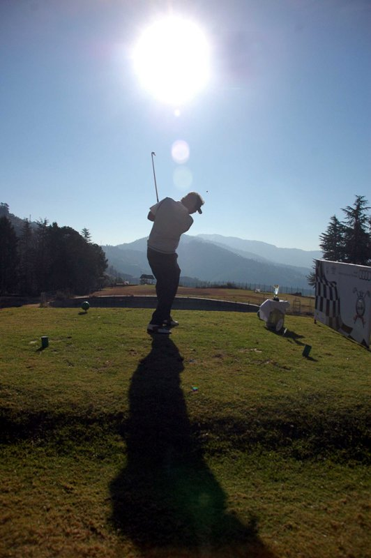 A golfer tees off during the 9-hole tournament organized by Times Group in association with Himachal Tourism and Audi India at Naldehra 22Kmls from Shimla on Sunday. 44 players including businessmen, army and police officers and bureaucrats participate in the Times Group invitational Golf Tournament.Photo TOI