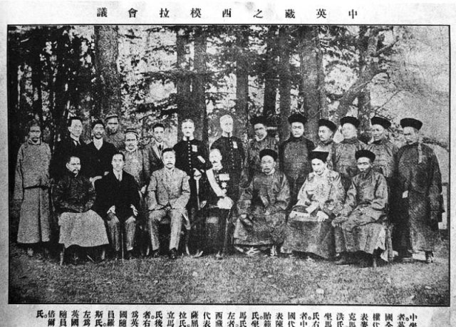 Representatives of Tibet, Great Britain, and China at Simla Accord 1914. Front row, from left: an assistant to Ivan Chen; Sekyong Trulku, Prince of Sikkim; Ivan Chen, Chinese plenipotentiary; Sir Henry McMahon, British Plenipotentiary; Lonchen Shatra, Tibetan Plenipotentiary; Teji Trimon, assistant; Nedon Khanchung, Secretary.