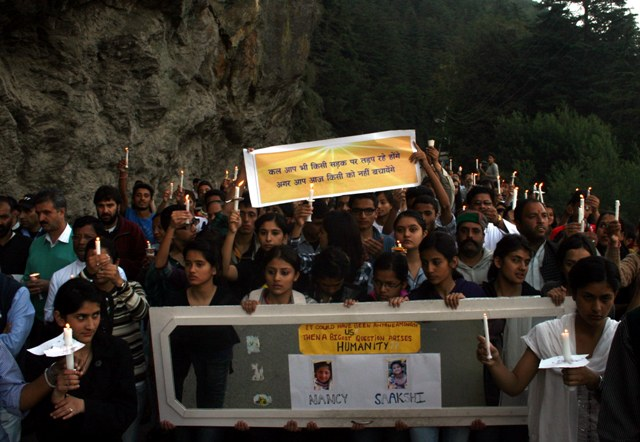 School children hold a candle light peace march in memory of two school student of Convent Jesus and Mary who died under mysterious circumstances a weak ago in Shimla on Sunday.photo toi