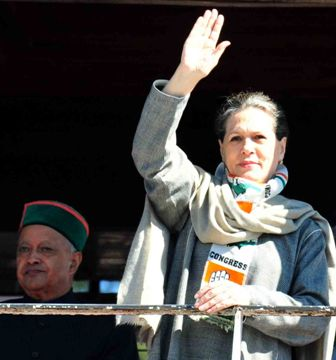 Sonia Gandhi waves to the election rally crowds at The Ridge Shimla