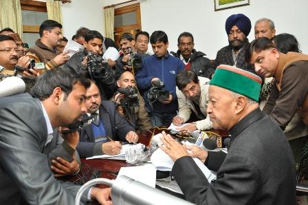 CM Virbhadra Singh talking to reporters at Dharamshala