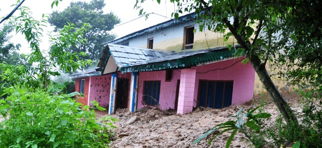 A house damaged in Chola Village near Dharamshala - Photo by Cartoonist Arvind