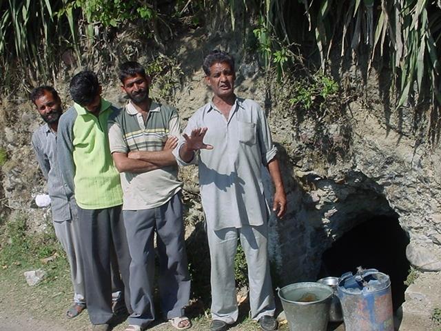 people-stand-outside-a-khatri.JPG