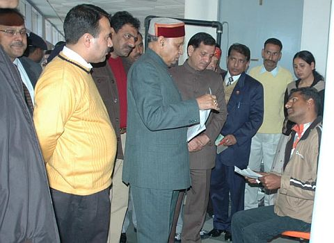 PK Dhumal Chief Minister giving a patient hearing to the grievances of a handicapped person  at Dharamshala
