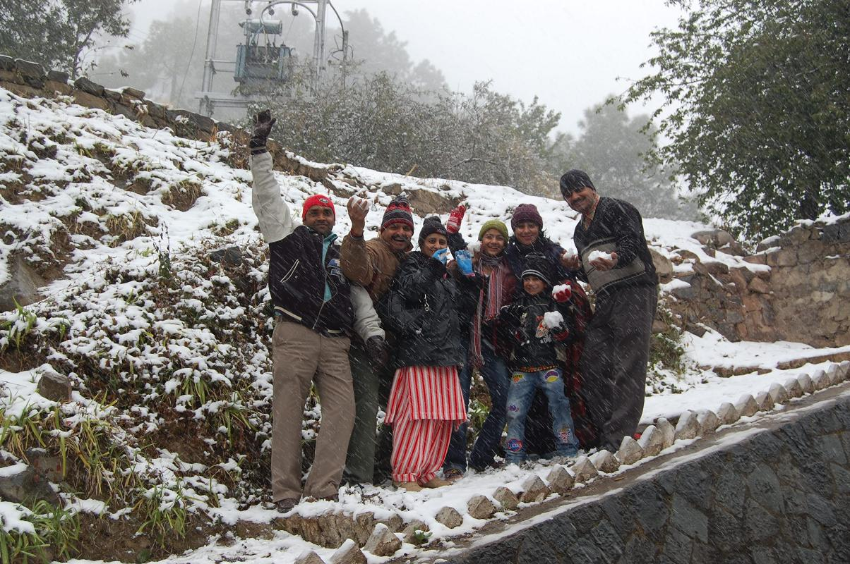 tourist enjoying snow at Barog