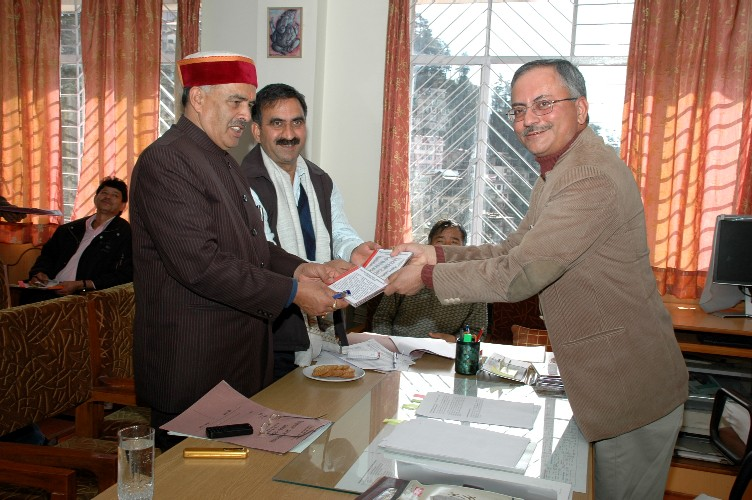 Himachal CEO presenting C.D. of electoral to Sukhvinder and one more candidate
