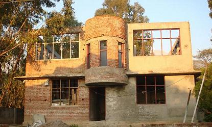 A half completed guest house of HPTDC at Neugal Café, Palampur. Construction of this building was taken up in the year 2006.