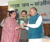 CM handing over herbal plant