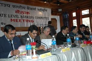 Chief Secretary Asha Swarup, CMD UCO SK Goel presiding over state bankers meet