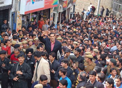 Great Khali under security and a fan following on The Mall Road