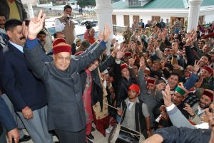 A beaming Dhumal, dancing to the country music