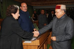 Chief minister greeting the leader of the opposition 'Vidya Stokes before start of the session