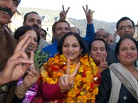 Madhu Sood with a victory sign on being elected mayor