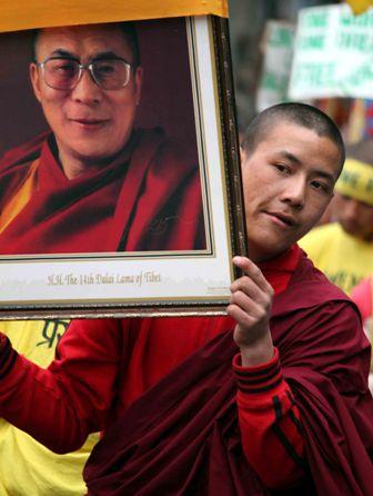 On Uprising Day, a Tibetan protestor with Dalai Lama's portrait in Shimla: Photo By Amit Kanwar