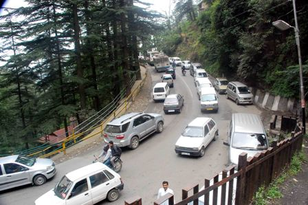 Vehicles stand on road due to traffic jam near Khalini in Shimla on Saturday.Photo by: Amit Kanwar