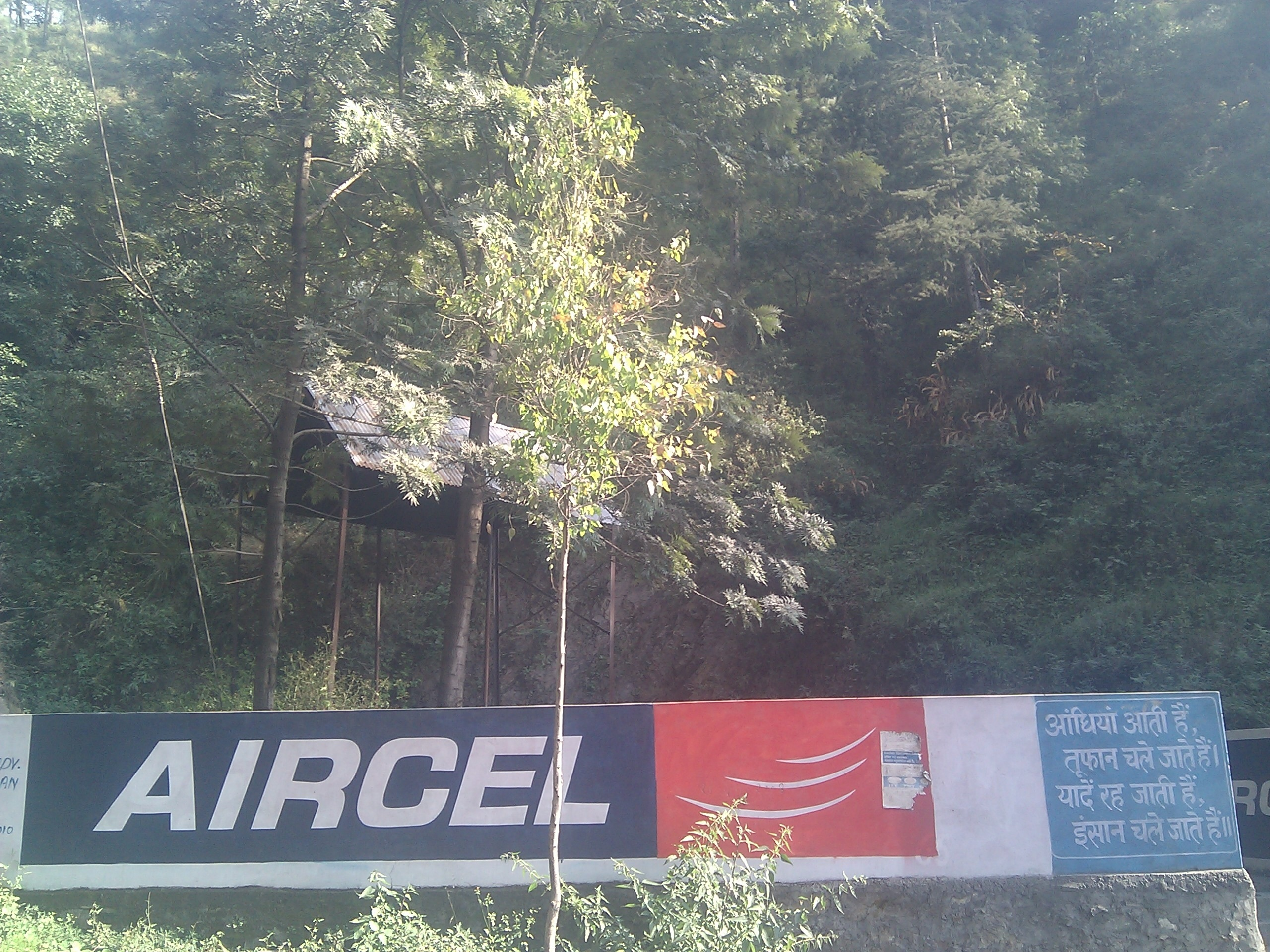 Cheap Aircel hoarding at a Kalka-Shimla highway crematorium