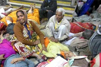 People crying after the stampede on a railway platform in Allahabad. PTI Photo