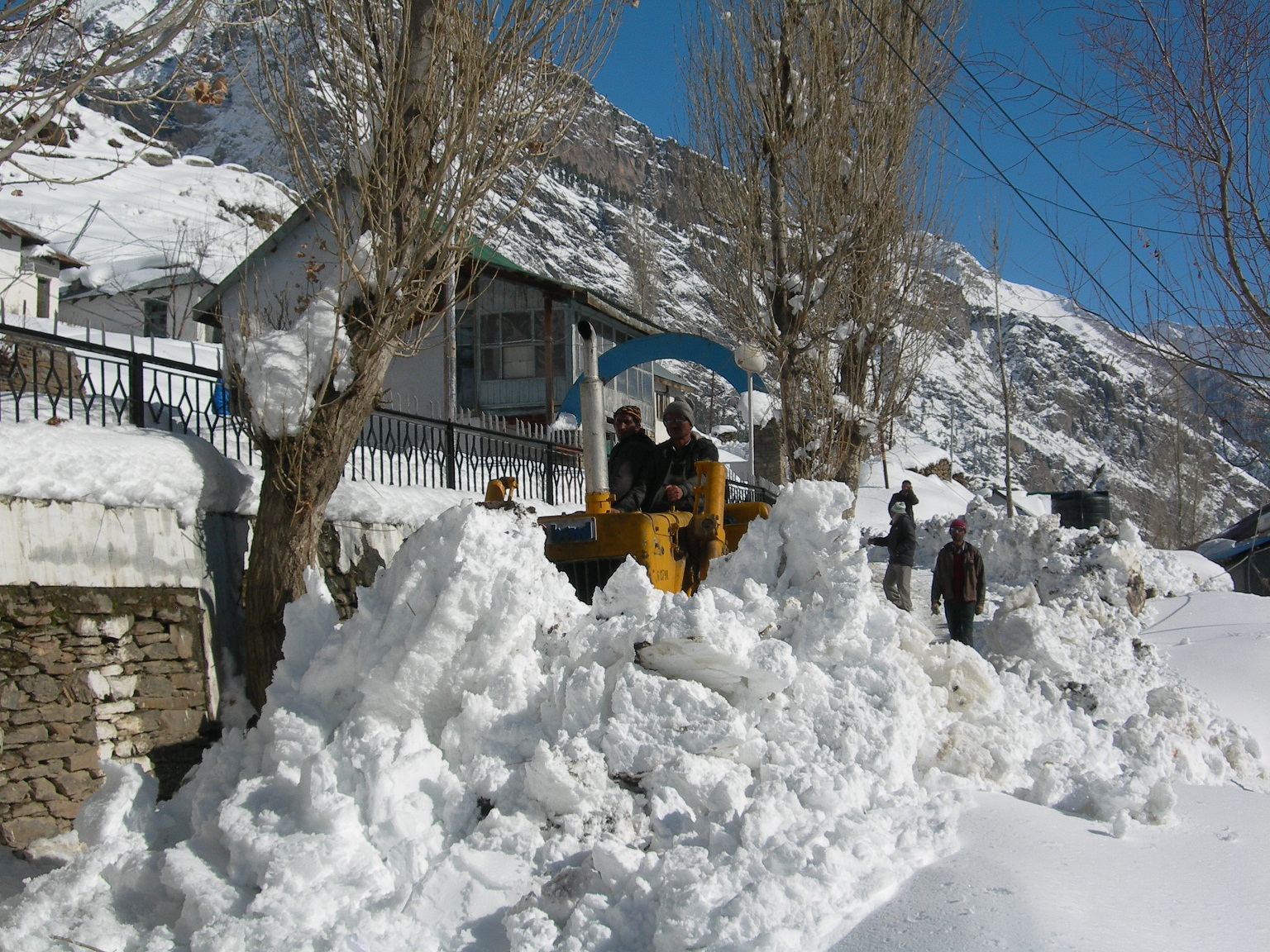 dozar clearing road in winter
