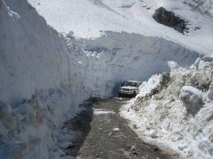 Chipping through 100 feet of snow to open a mountain pass