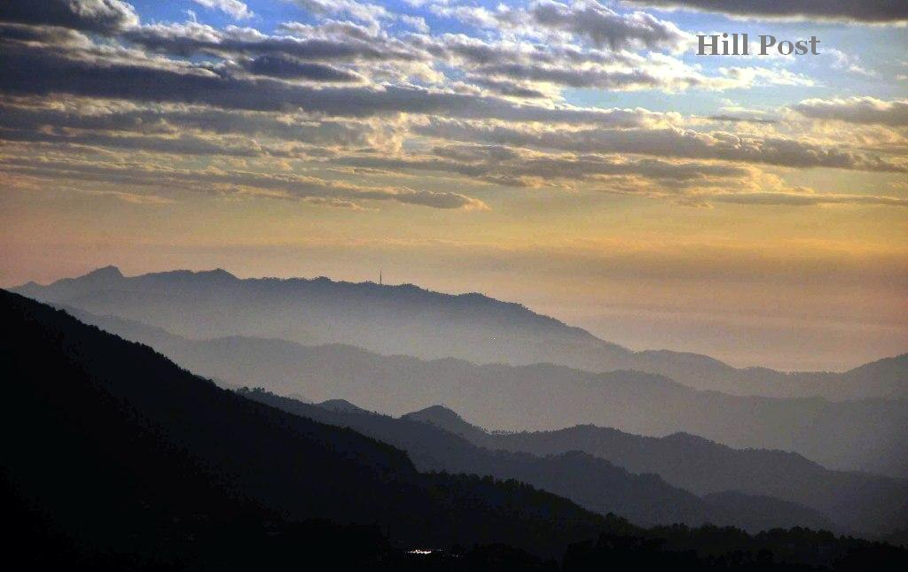 Various mountain ranges visible under the clouds in the northern hill town of Shimla