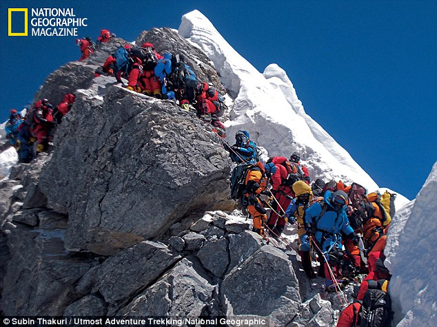 Traffic chokes the Hillary Step on May 19, 2012. Some climbers spent as long as two hours at this 40-foot rock wall below the summit, losing body heat. Even so, 234 people reached the top on this day. Four climbers died Photo Courtesy: National Geographic