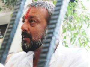 Crowds jostle as Sanjay Dutt leaves home for jail