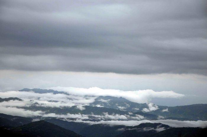 Fog envelops the hills after rain in Shimla on Friday