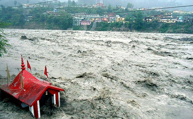 A temple submerged in flooded river Ganga due to heavy rains in Uttarkashi. PTI