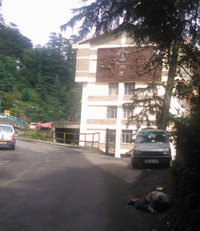 State of affairs - a drunk man lying outside the state police headquarters in Shimla.