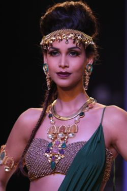 A model showcases creations from jewellery designer Sumit Sawhney's Carved Incarnations line.