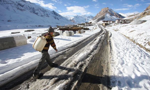 A view of snow-marooned village on the outskirts of Keylong town in Himachal Pradesh's Lahaul-Spiti district.