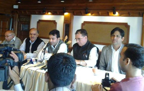 Arun Dhumal flanked by other BJP leader at media conference