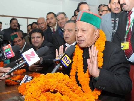 Virbhadra Singh talking to reporters at his official residence Oak Over