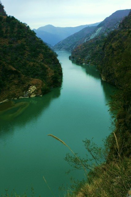 4.The stillness of the back waters of Pandoh Dam engulfs the mountains and blurs the identity of the Beas as a river.