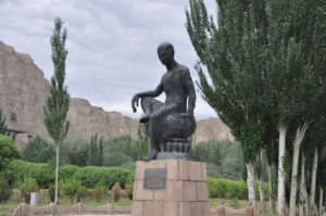 The Statue of Kumarayana in front of the Kizil Caves in Kuqa County, Xinjiang, China